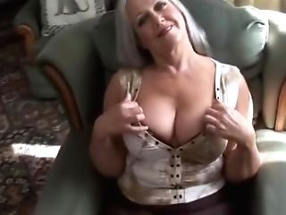 Attractive Big-titted Granny In Stockings Disrobing