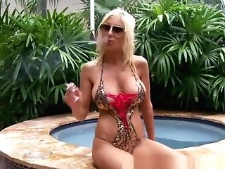 Euro Cougar Puma Swede Thumbs Her Poon In The Jacuzzi!